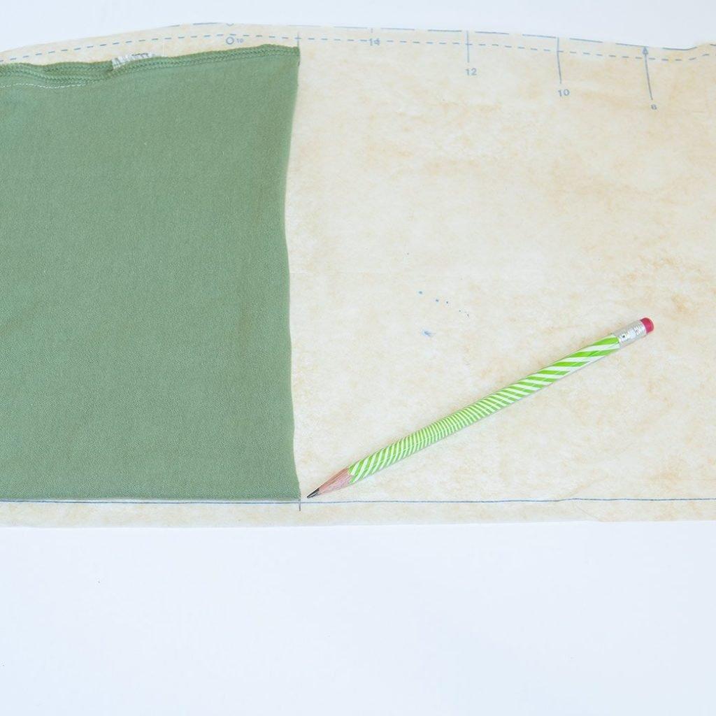 marking camisole hem on pattern to make a full slip