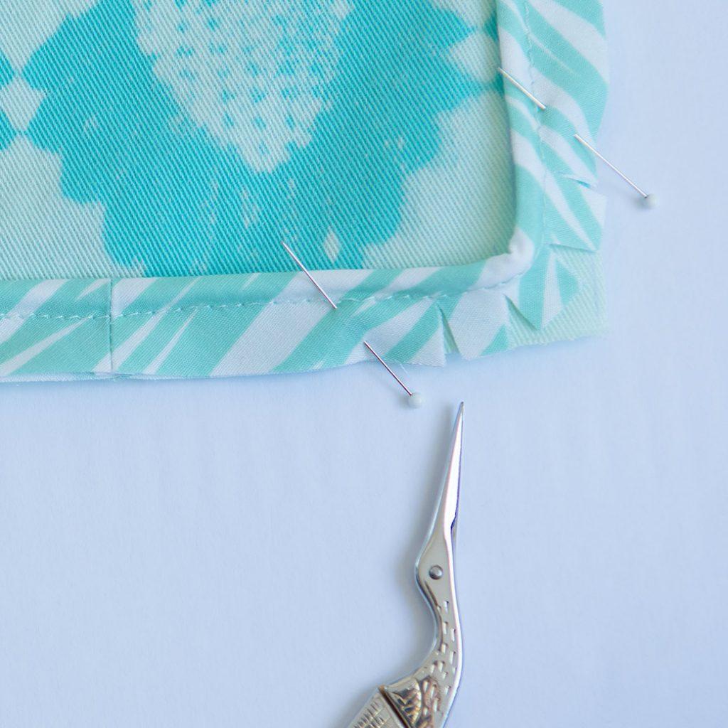 pinning corner of piping on cushion
