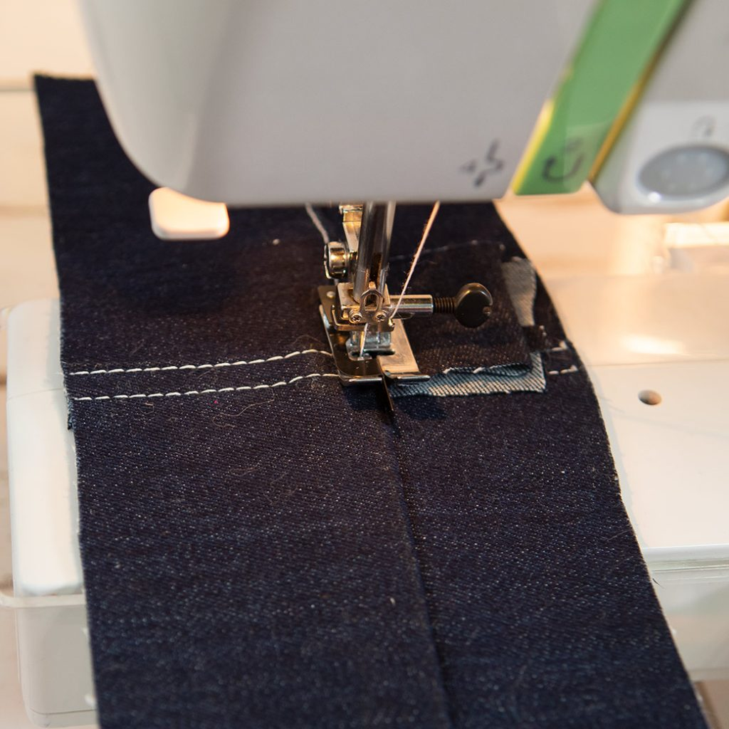 leveling out machine foot with scrap of fabric on side