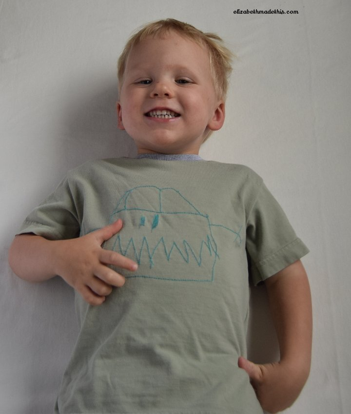child wearing an embroidered t-shirt