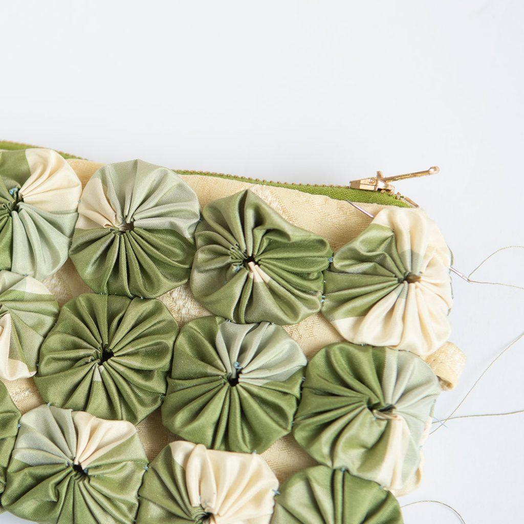 stitching overlay to wristlet purse