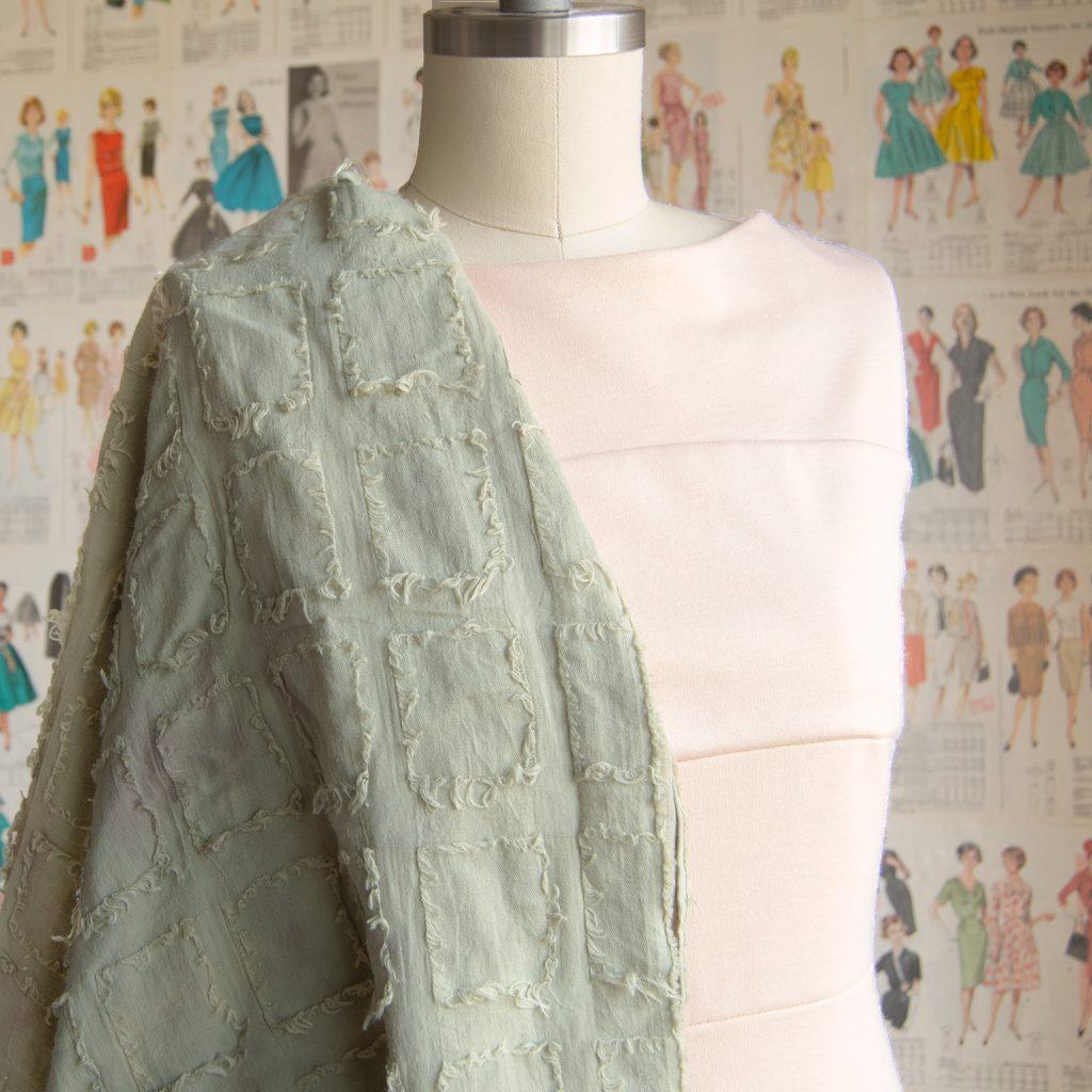 peach ponte dress draped with moss green cotton