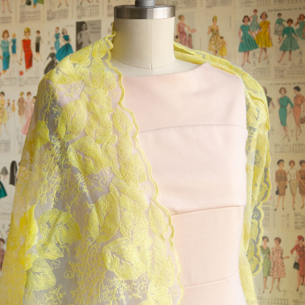 peach ponte dress draped with sheer yellow embroidered organza