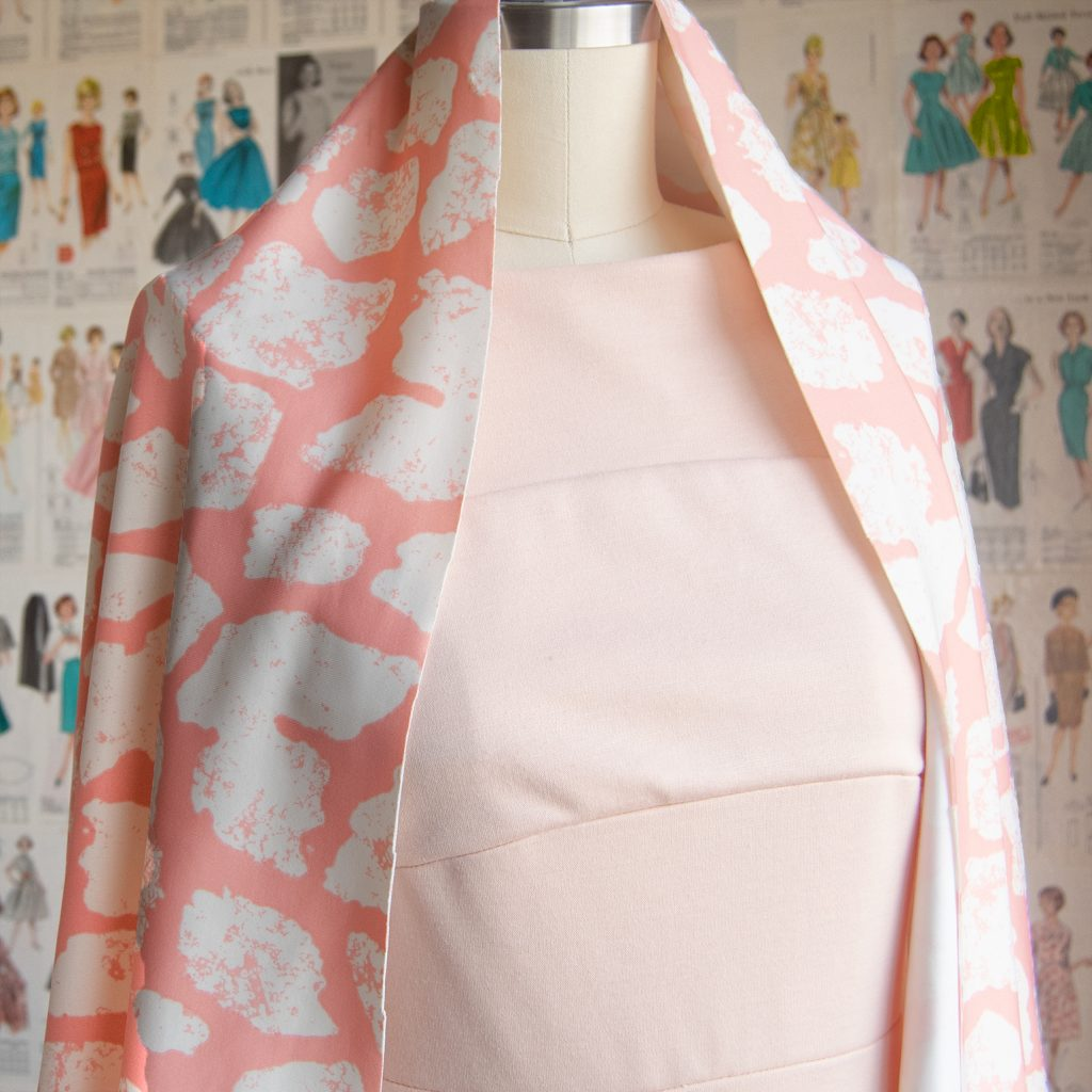 peach ponte dress draped with bright salmon and white scuba knit