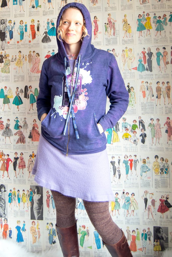 woman wearing orchid sweater dress styled with purple hoodie