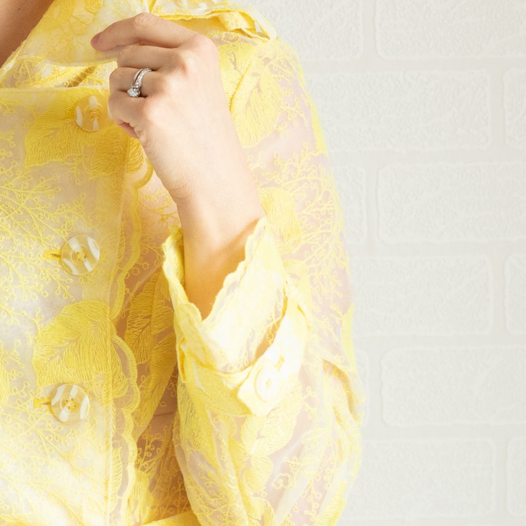 yellow white striped buttons on yellow embroidered organza trench coat