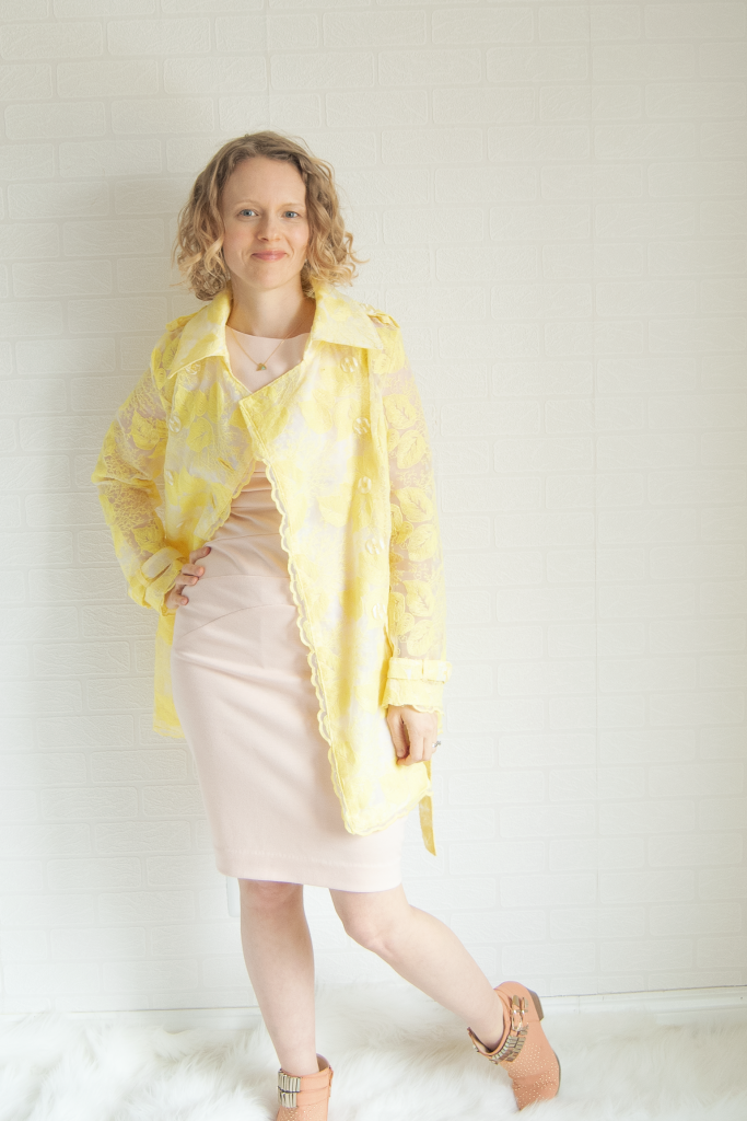 yellow embroidered organza trench coat, blush pink dress, and peach booties