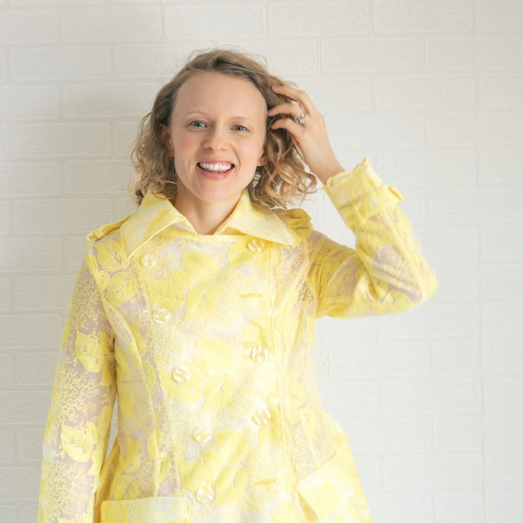 closeup of yellow embroidered organza trench coat