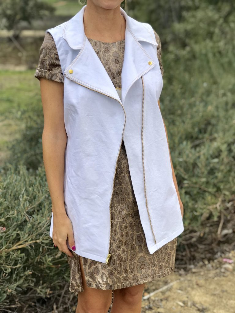 closeup of white denim motorcycle vest and Named Inari dress