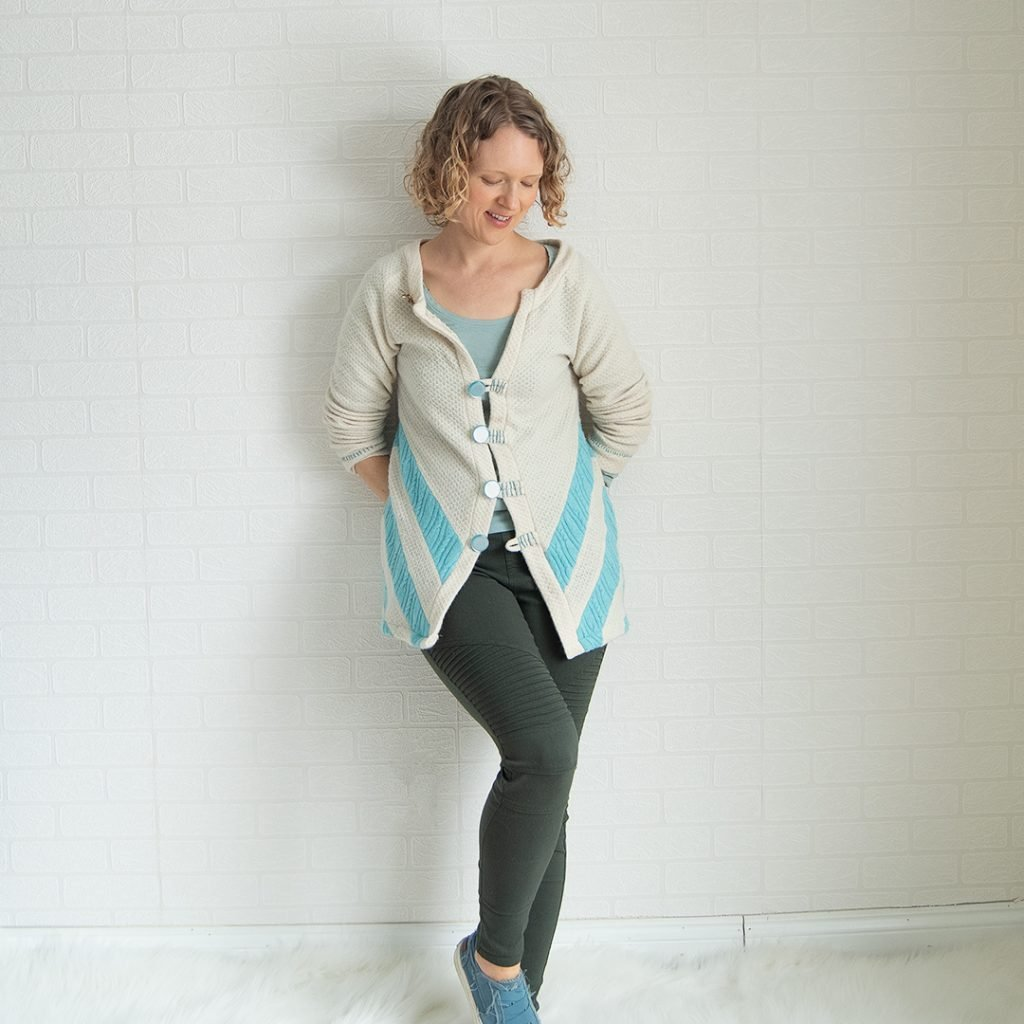 thrift store refashion of a ivory poncho into a chevron sweater with buttons