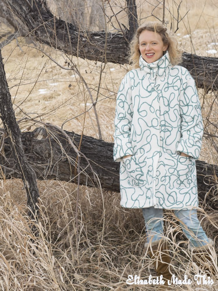 yarn covered coat by tree