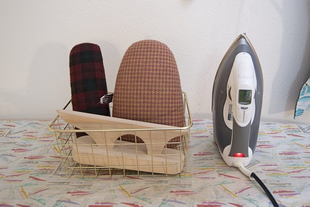 tailoring tools in a basket by iron