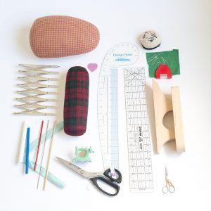 flatlay of helpful sewing tools