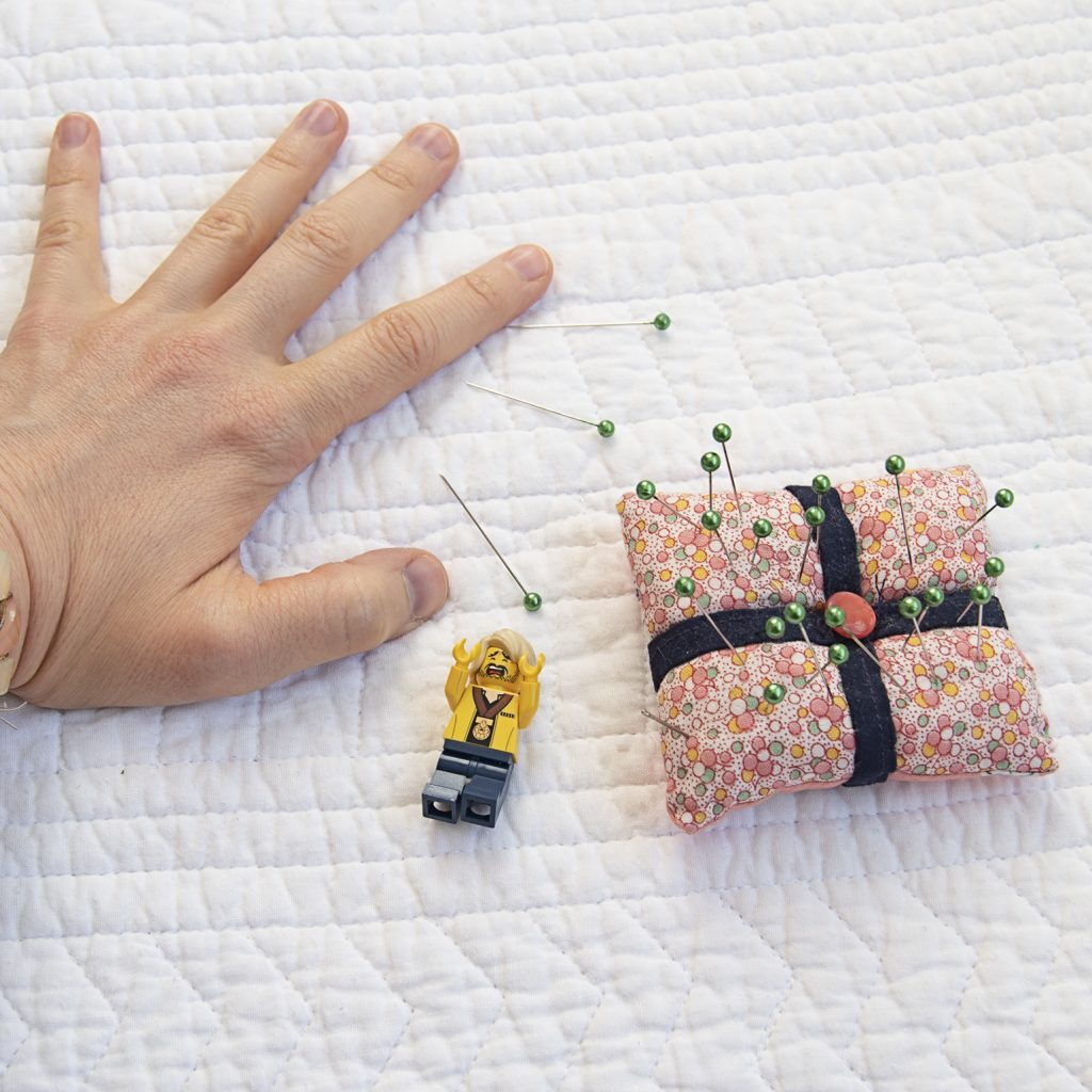 lego guy, hand, pincushion