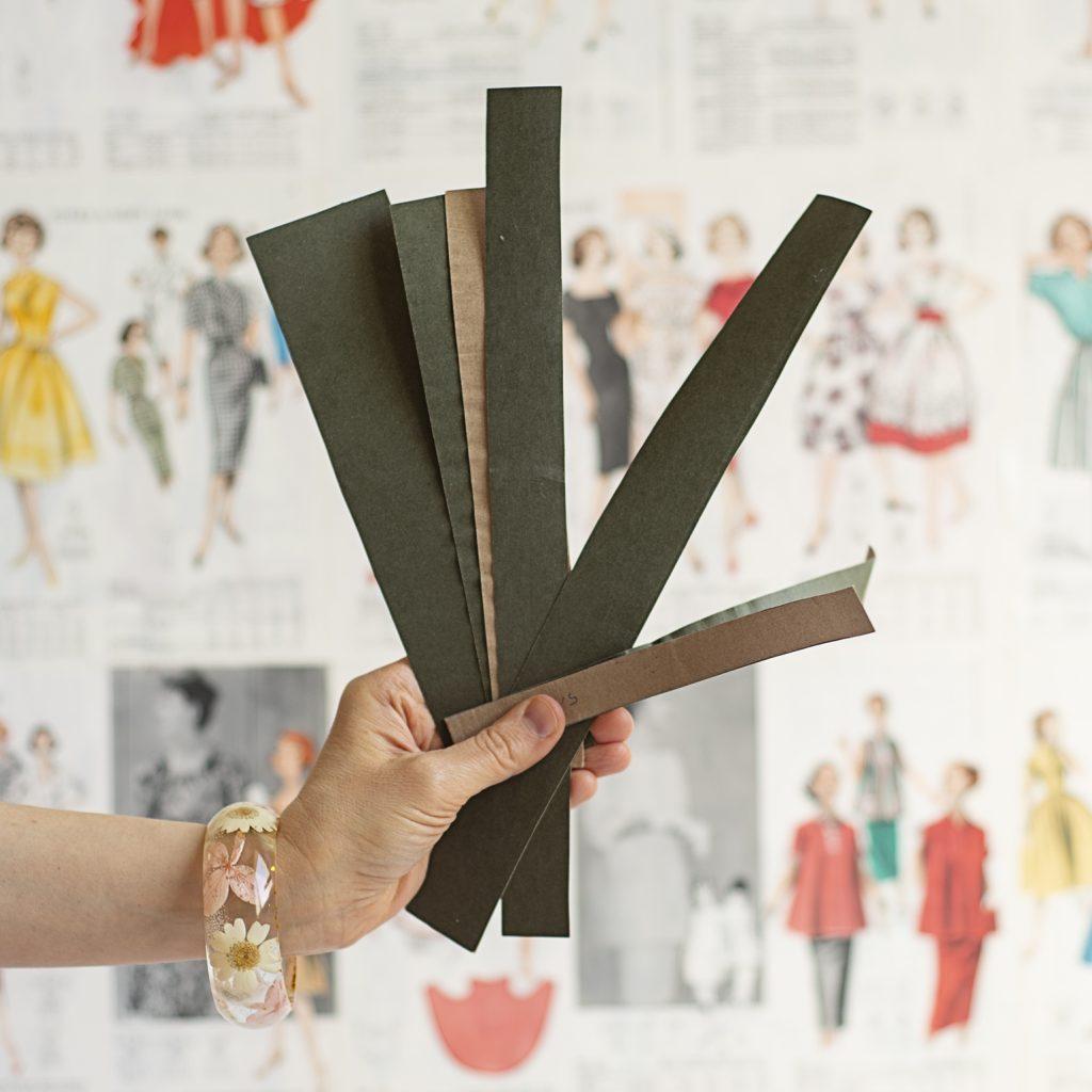 strips of file folders for pressing hems
