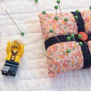 lego minifigure and pincushion
