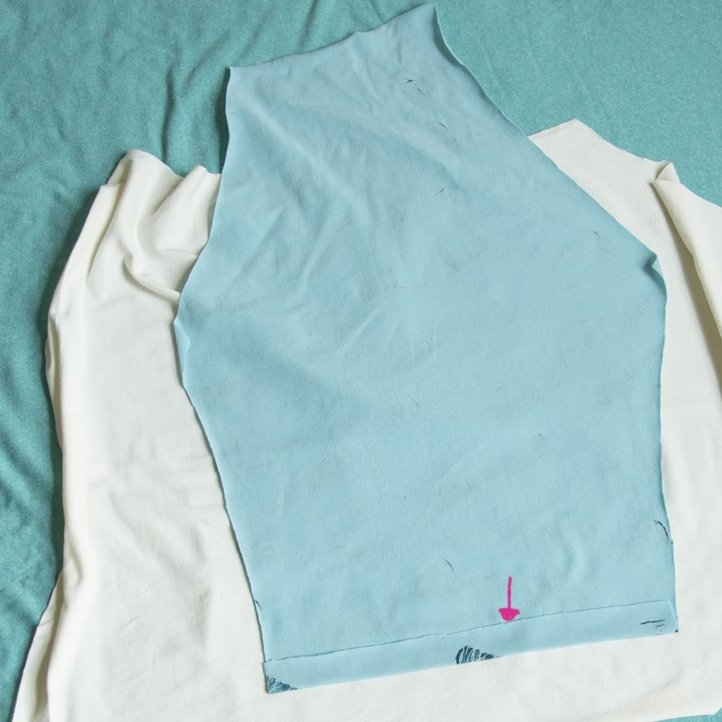 sleeve piece of a diy raglan tee: pink arrow shows a pressed up hem