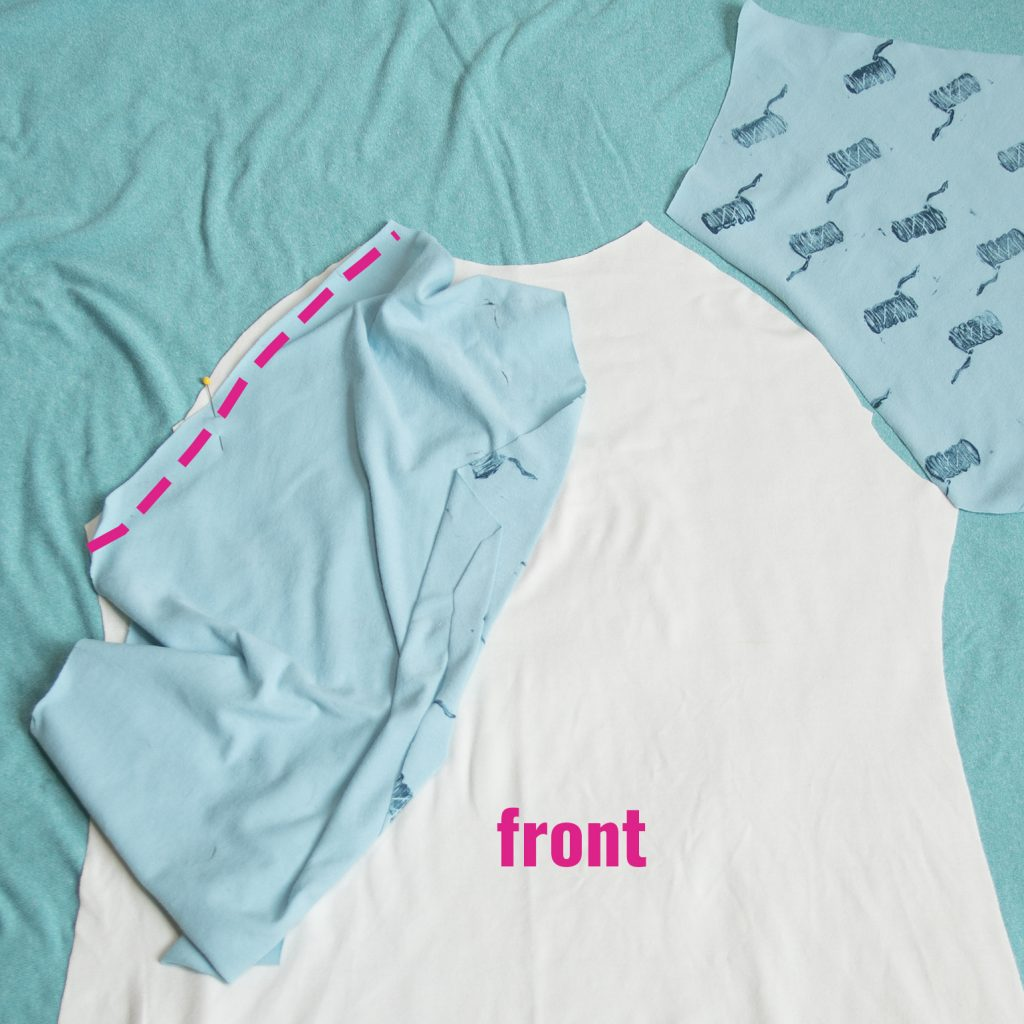 front and sleeve pieces of a diy raglan tee: pink line showing where to sew a front sleeve seam on a diy raglan tee