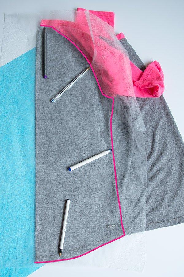 tracing seams on back piece of a raglan t-shirt for a diy raglan t-shirt pattern