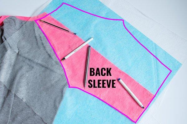 tracing the back sleeve of a raglan t-shirt for a diy raglan tee