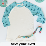 "Pinterest image reading: ""sew your own easy diy raglan tee"" pictured are sew your own raglan tee ingredients: scissors, sewing machine needles, thread with the finished diy raglan tee"