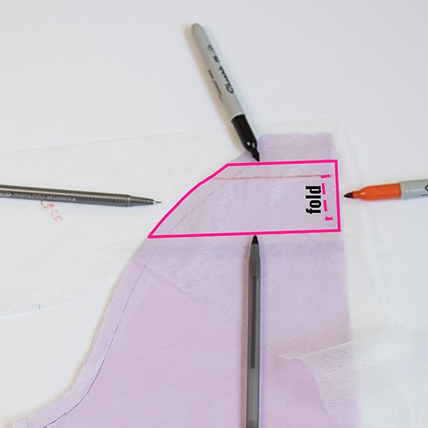 picture showing where to trace on the back piece of a raglan tee to make a facing for a diy sleeveless raglan tee