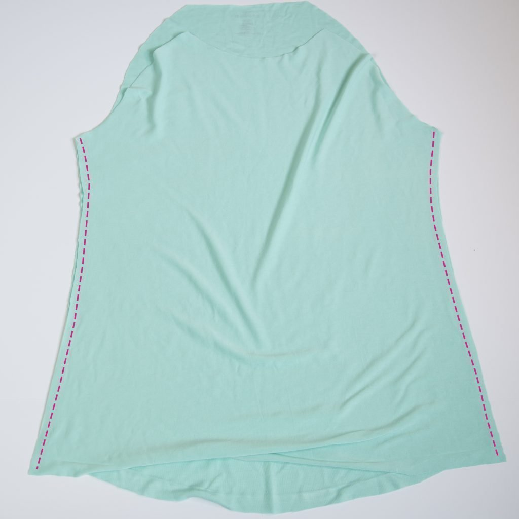 diy sleeveless raglan tee and a pink line showing where to sew the side seams