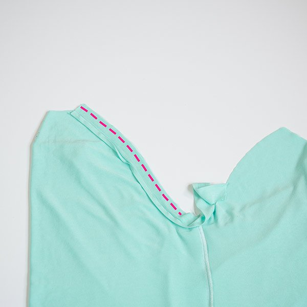 picture showing diy sleeveless raglan tee armhole and pink line showing where to sew on the armhole binding