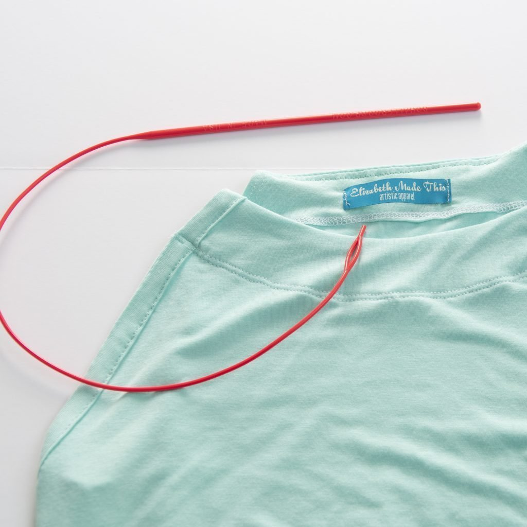 elastic threader through the casing on a pulling the scarf through the casing on a diy sleeveless raglan tee