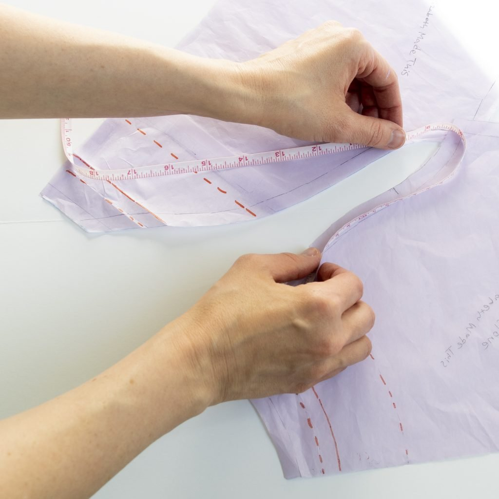 measuring the seamline on the armhole of a raglan tee