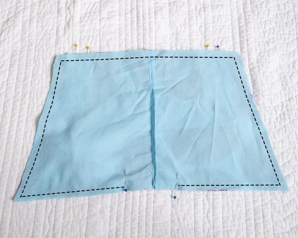 apron bib pieces right sides together with a line showing where to sew