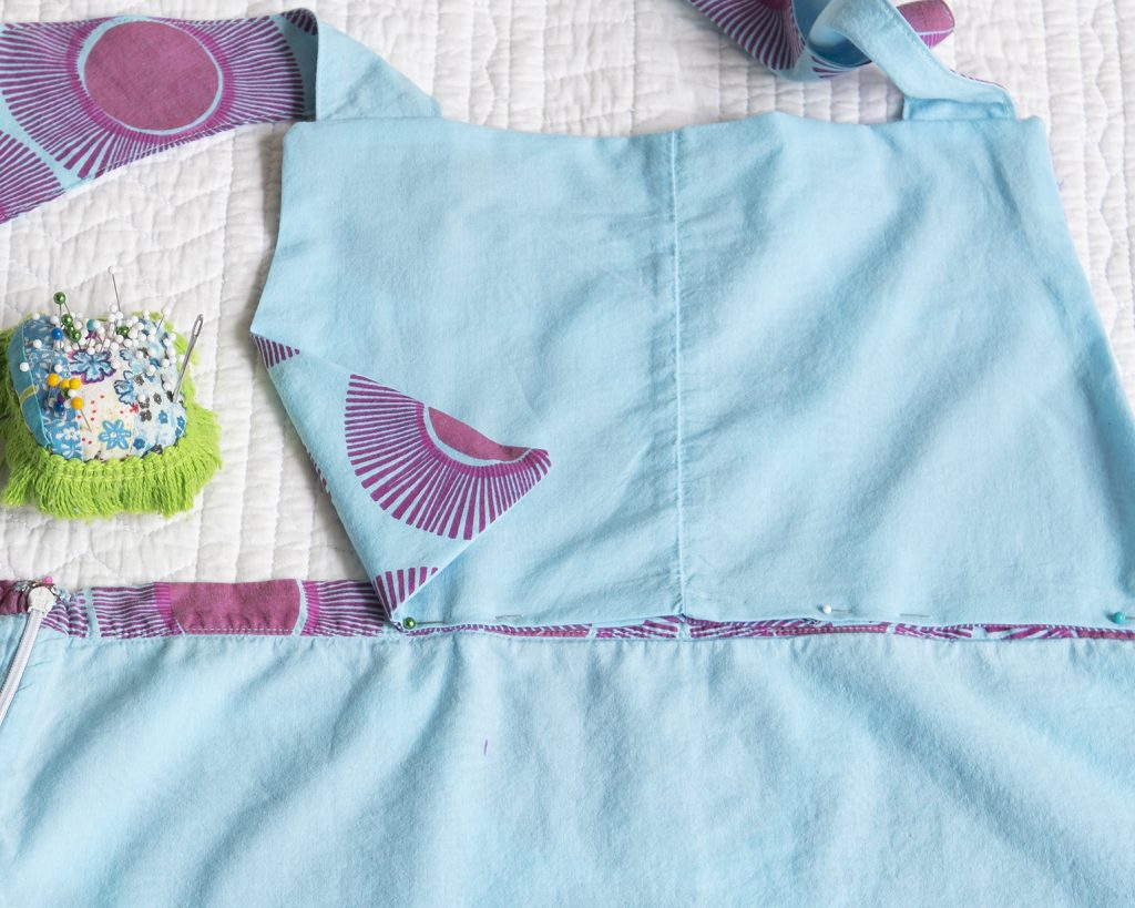 pinning an apron bib and apron skirt together
