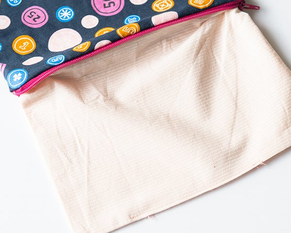 sewing hole in bottom of zipper bag