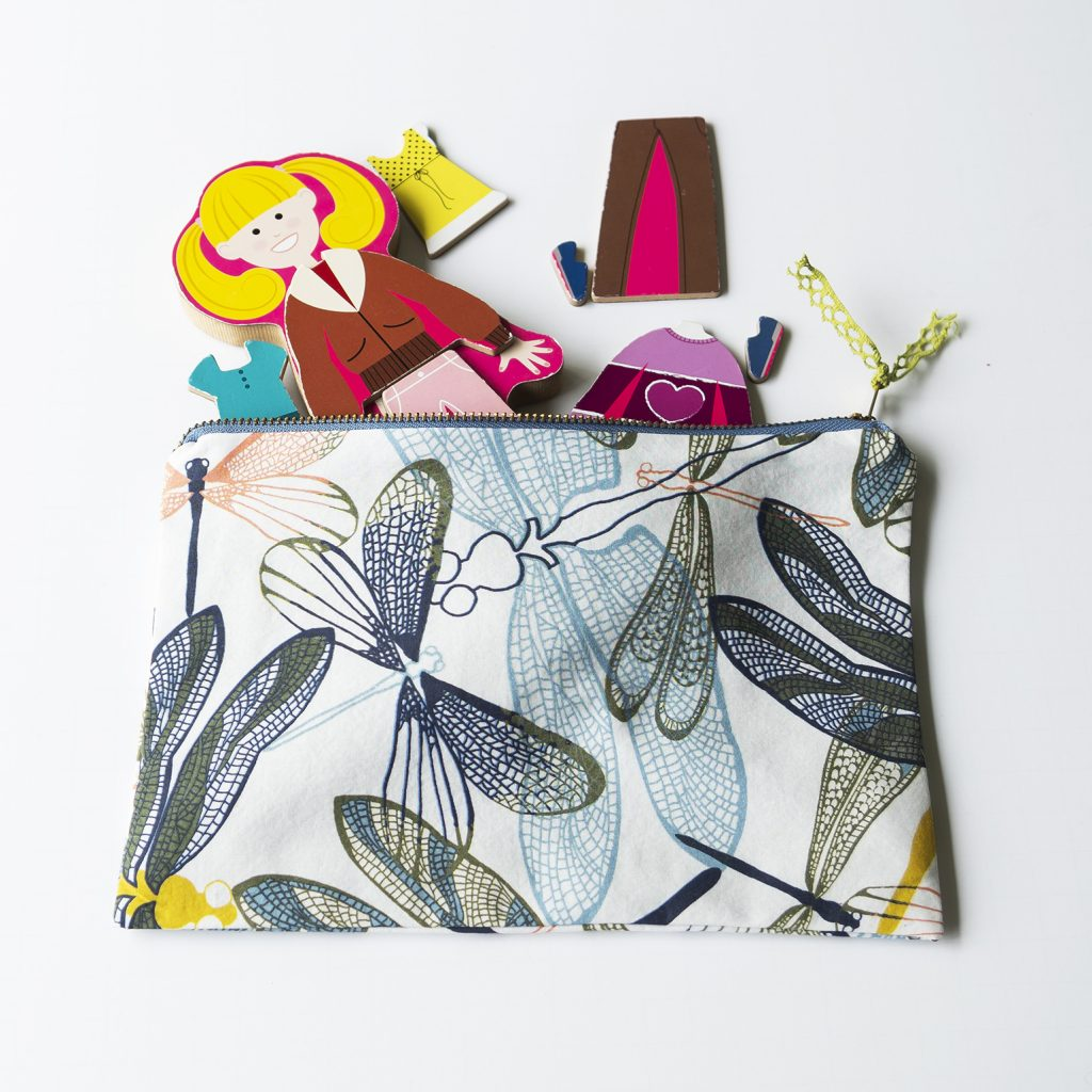 zipper bag holding magnetic paper doll pieces
