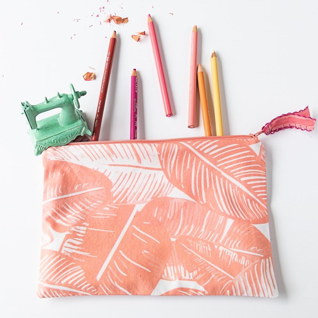 zipper bag holding colored pencils and a sewing machine pencil sharpener