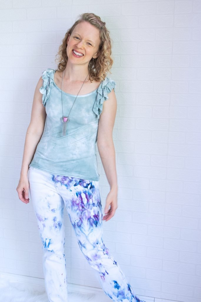 woman wearing ice dye jeans and t-shirt