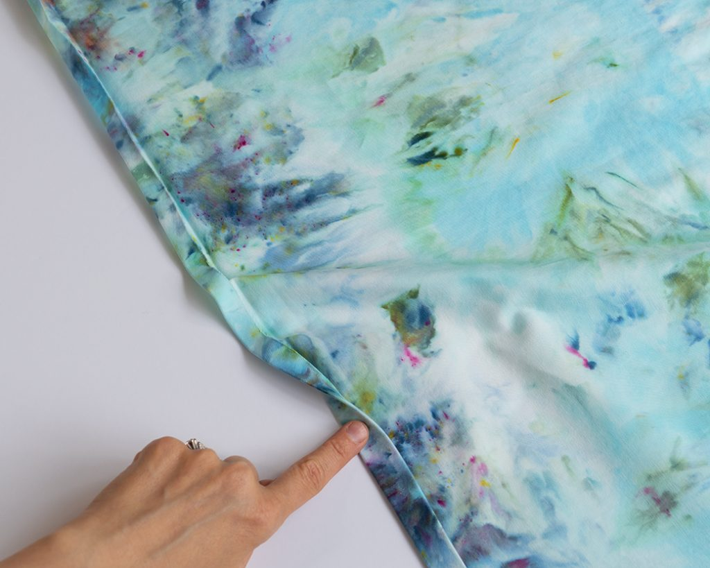pressing up hem on ice dye fabric
