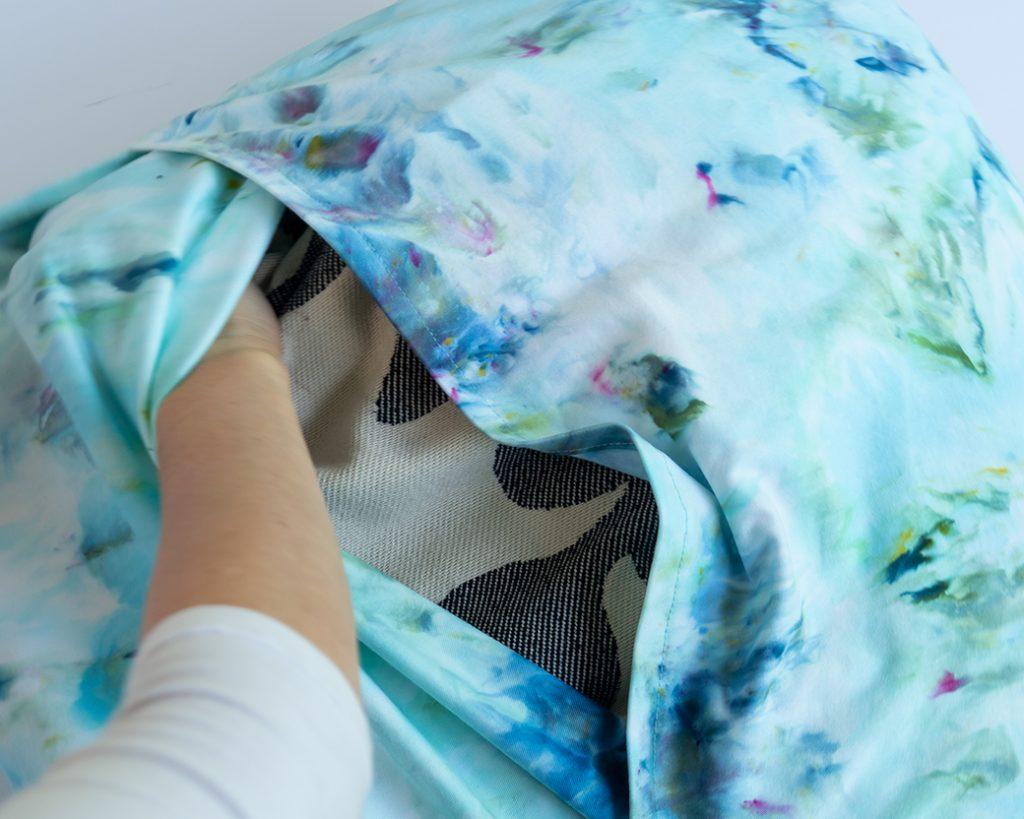 fitting pillow inside pillowcase