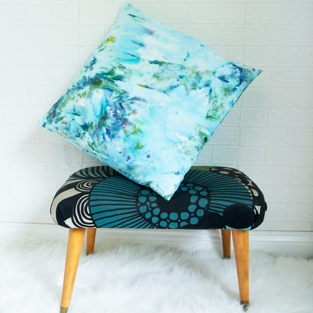 DIY ice dye pillow on stool