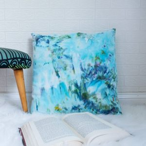 ice dye pillow with a book