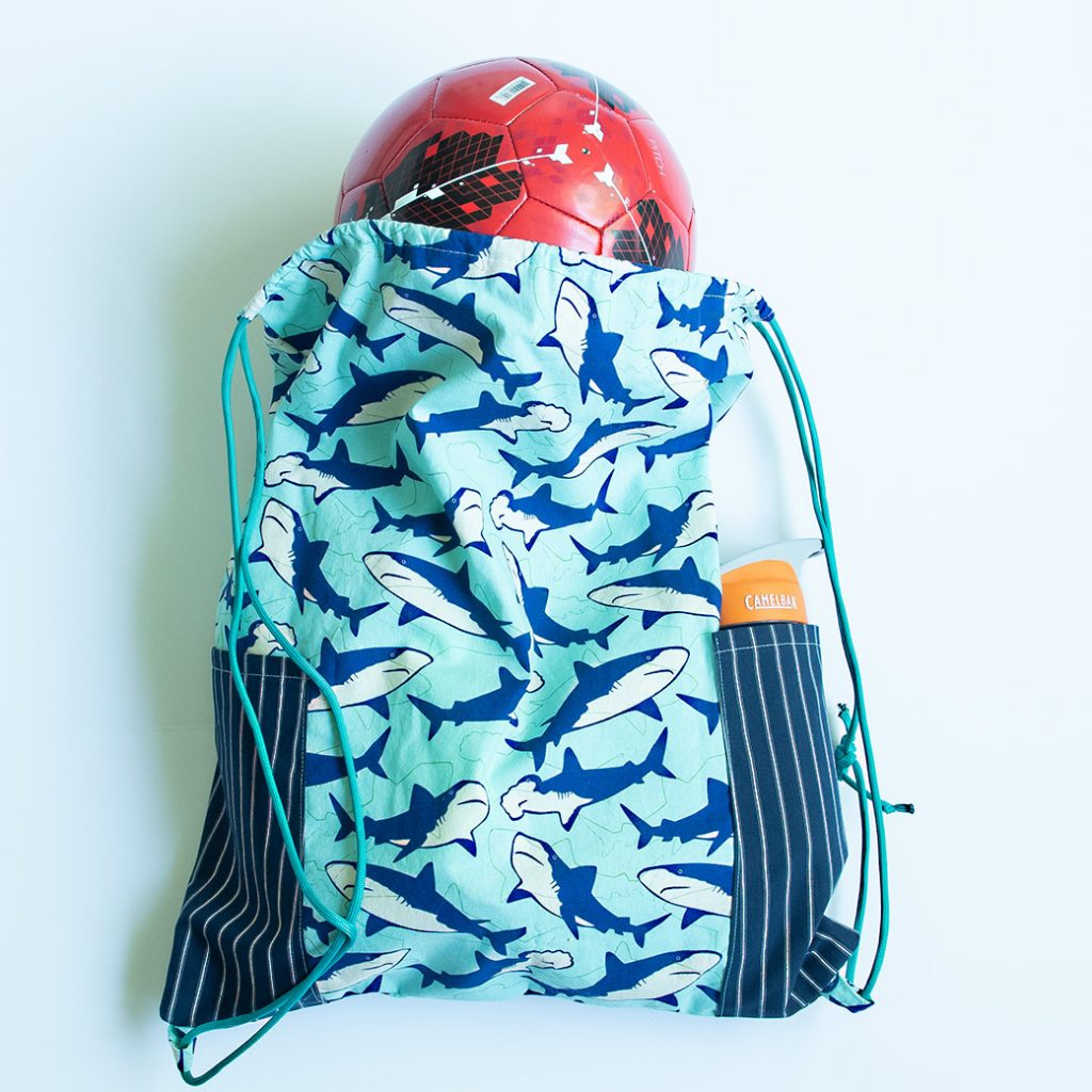 drawstring backpack with water bottle and soccer ball