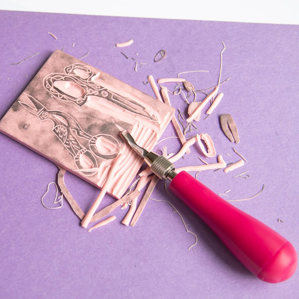in process of carving a block print stamp