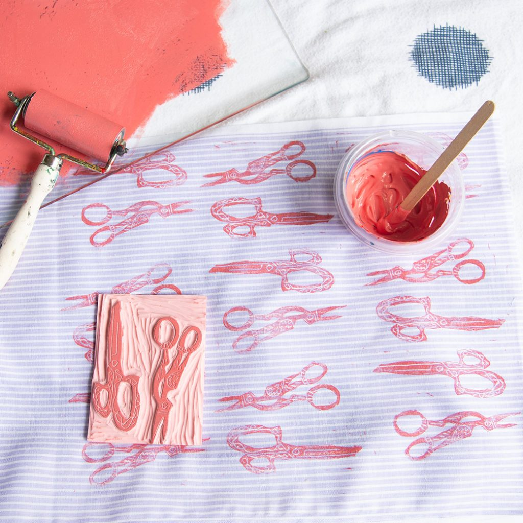 supplies for how to block print fabric: fabric, ink, stamp, brayer