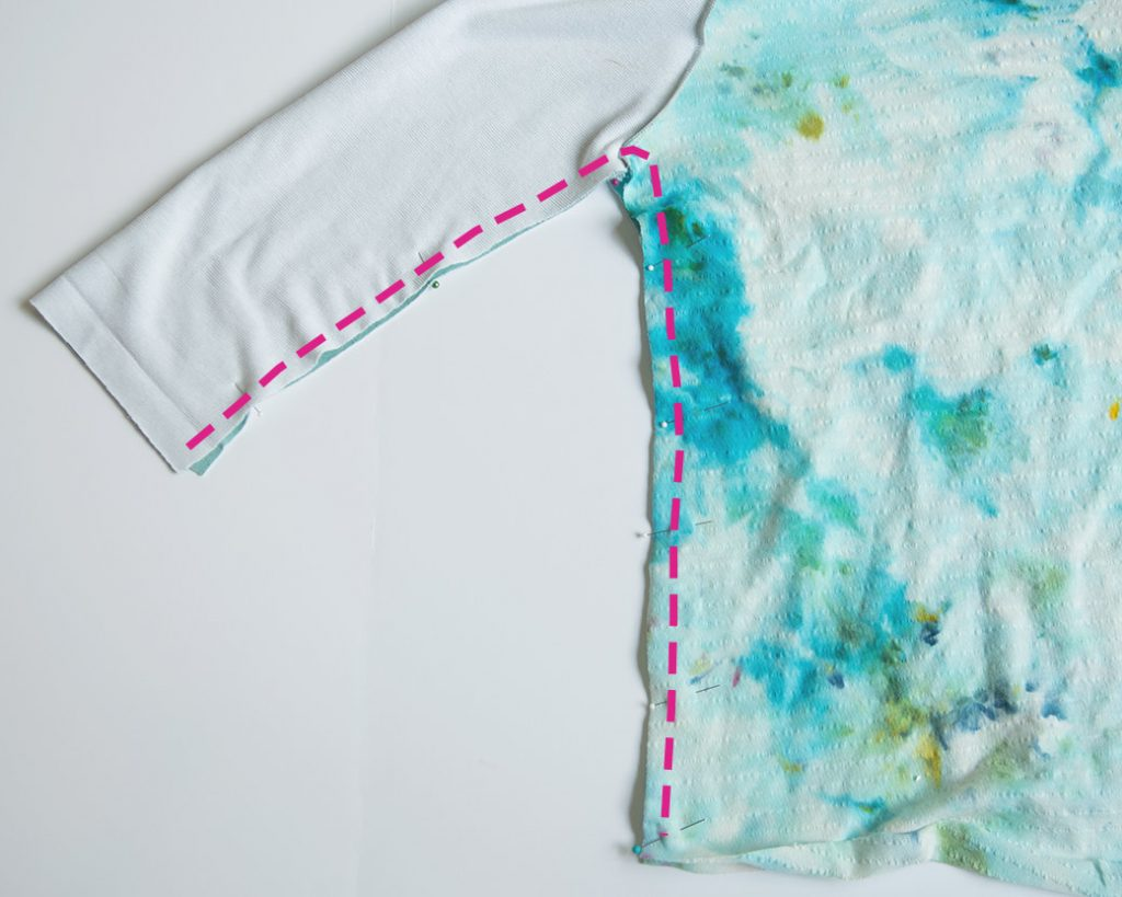 pinning side seams of lace applique shirt
