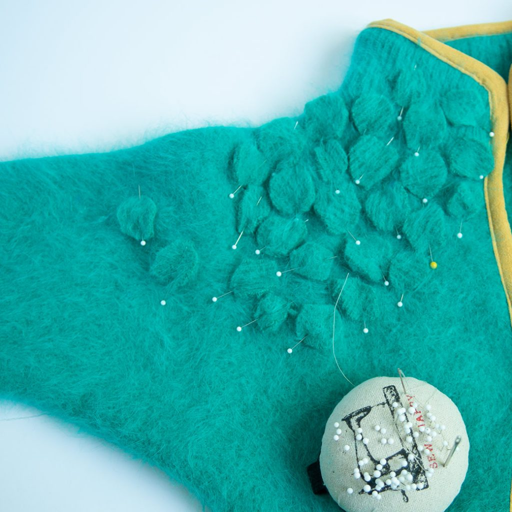 pinning wool circles on refashioned sweater shrug