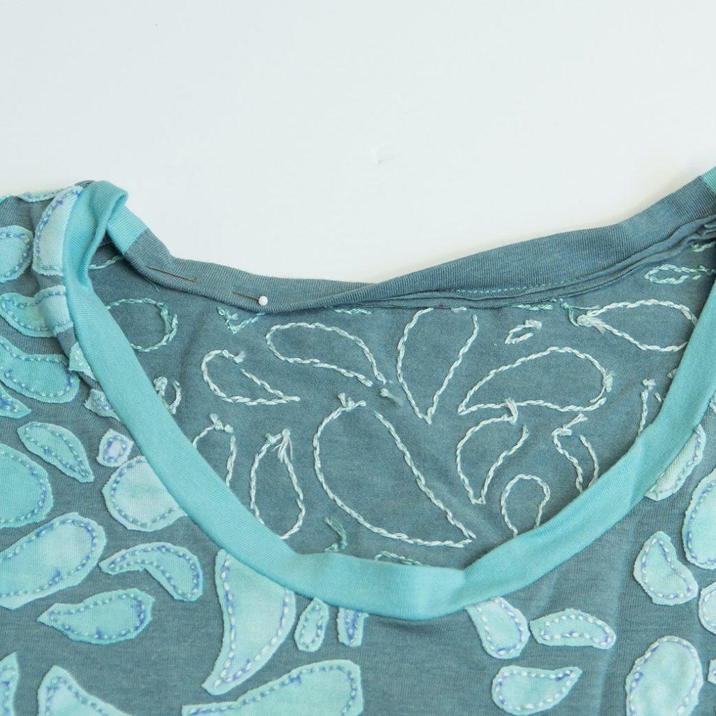 folding binding to inside of t-shirt