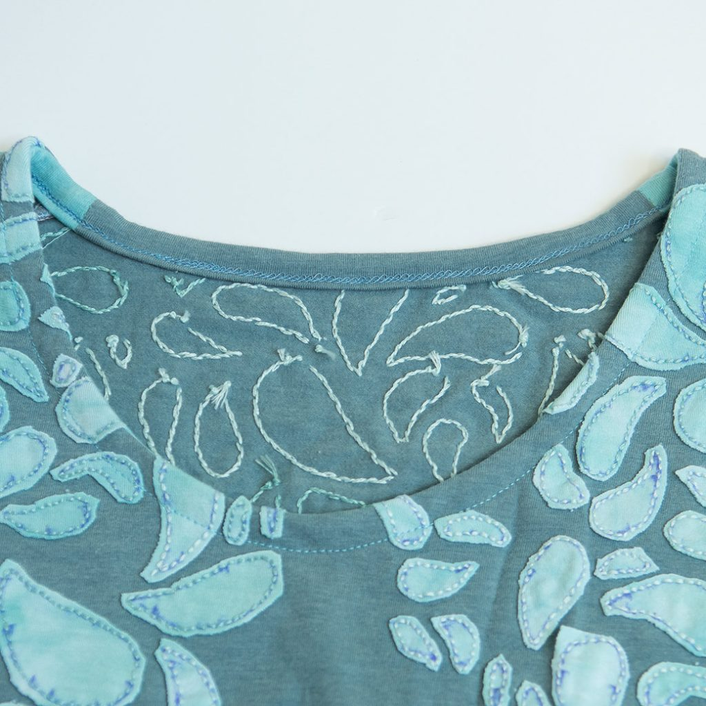 coverstitched knit neckline clean finish