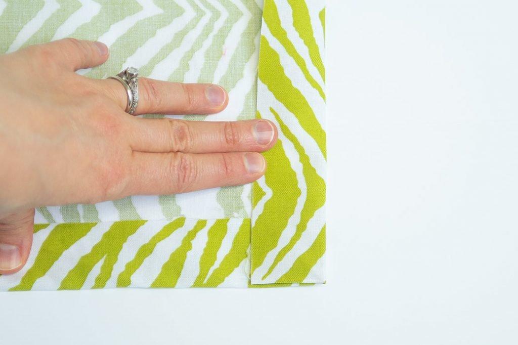 folding a hem for a mitered corner