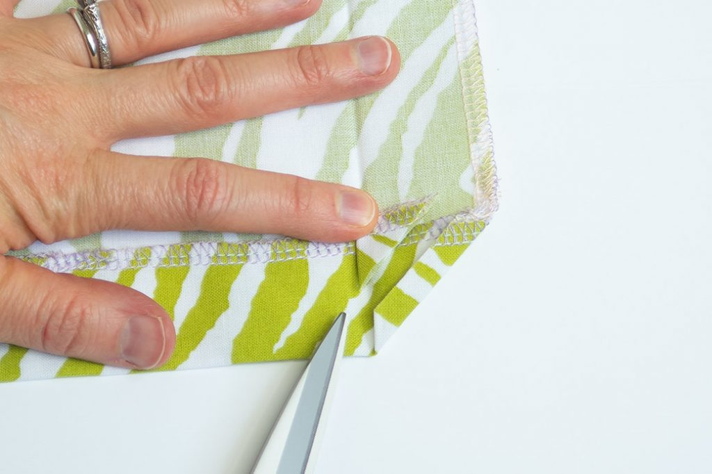 sew a mitered corner: trim away the extra fabric
