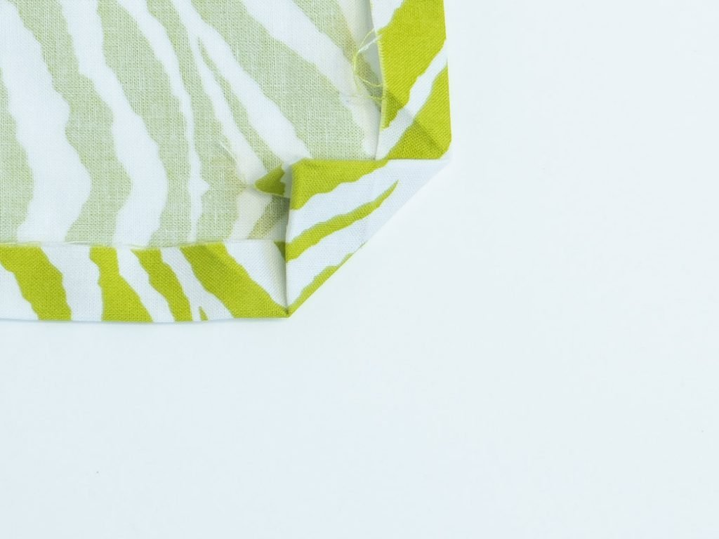 fold back corner on a mitered corner